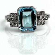 LUV. Interesting design. Pretty! RESERVED Art Deco Aquamarine and Diamond Ring $3250. glacier blue emerald cut aqua marine weighing appx 2.65 ct, original art deco ring crafted in platinum in the 1930s. Twelve single cut diamond accents adorned with a sweet milgrain design. Size 6 1/2 and easily sized. $3,250.00 - See more at: https://vintagediamondring.com/art-deco-aquamarine-and-diamond-ring.html#sthash.pCOHM4xF.dpuf