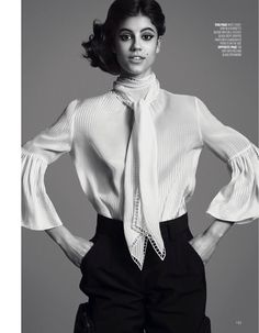 Striking a pose, Antonina Petkovic wears Fendi white pussy bow blouse and crepe pants