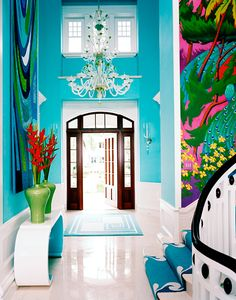 "Electric colors make this entrance and stairway scream ""welcome"" via Anthony Baratta"