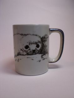Otagiri Japan, Mug, Seal Pup on ice. Cream colored up, browns and grays make up this beautiful mug. Adorable drawing of baby seal. Mug is in excellent
