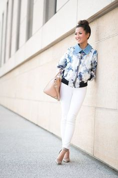Shop this look for $205:  http://lookastic.com/women/looks/white-skinny-jeans-and-grey-heels-and-light-blue-bomber-jacket-and-beige-handbag/1664  — White Skinny Jeans  — Grey Leather Pumps  — Light Blue Floral Bomber Jacket  — Beige Leather Handbag
