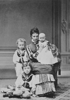 Tsarina Maria Feodorovna of Russia, nee Princess Dagmar of Denmark, with her three eldest children; Tsarevich Nicholas (sitting on floor), Grand Duke George (standing behind Nicholas), and Grand Duchess Xenia (held) Maria Feodorovna, Tsar Nicolas, Tsar Nicholas Ii, Czar Nicolau Ii, Belle Epoque, Christian Ix, House Of Romanov, Princess Alexandra, Grand Duke