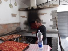 Pizza the old fashioned way in Italy. None of those cheezy pizzas. Proper tomato and herb ones.