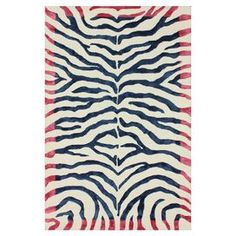 Wool and art silk rug with a tiger stripe motif.  Hand-knotted in India.    Product: RugConstruction Material: Wool and viscoseColor: Ice blue and pinkFeatures:  Hand-tuftedMade in India Note: Please be aware that actual colors may vary from those shown on your screen. Accent rugs may also not show the entire pattern that the corresponding area rugs have.Cleaning and Care: These rugs can be spot treated with a mild detergent and water. Professional cleaning is recommended if necessary.