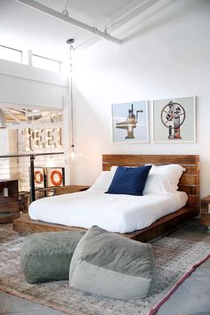 Cozy and modern bedroom with a wooden bed and warm colors. Great pendant light in shape of a light bulb.