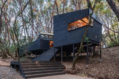 Rooted to the ground by a foundation of stilts, the Forest House is a modern campsite in the Northern California woods. The home is comprised of a series of small cabins, connected by a wooden path. These small structures house...