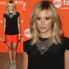 Orange is the new black for Ashley Tisdale, who paired a black All Saint tee with an orange Mason leather miniskirt