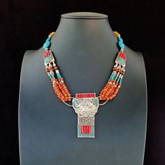 Necklace with embodied turquoise & coral, .625 silver elements, coral…