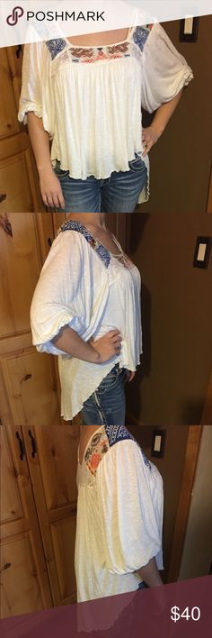 Free People Top Size medium Free People top. Pretty and fun peasant style high low white with embroidery neckline shirt. Very good condition wore a handful of times. I accept reasonable offers. Free People Tops Blouses