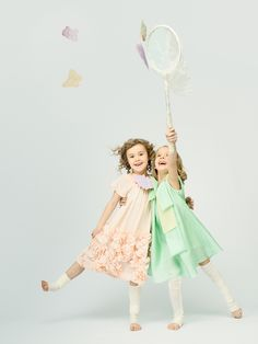 Katrina Tang Photography for ISE Kids SS 14. Studio shoot with two girls wearing dresses, catching butterflies #katrinatang #tangkatrina