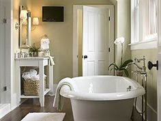 Shabby Chic Bathroom - I love the sink with the white towels in the basket underneath.