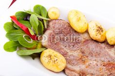 Food stock photos at Fotolia from $1.50:  Closeup Of Grilled Steak With New Potatoes
