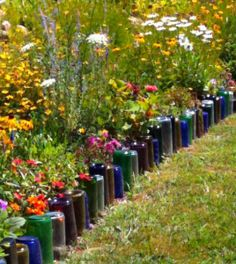glass bottle garden edging....green way to recycle all the wine, soda, and beer bottles