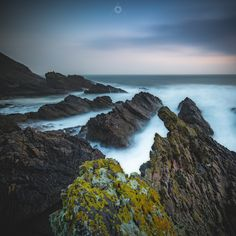 Falling Under - A long exposure, landscape image of rocks on the shores of Cullen Bay in Morayshire, Scotland, at sunrise.
