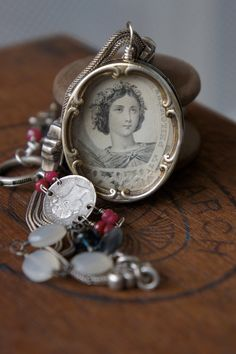 Antique Assemblage Necklace with French St Philomena Sacred Heart Reliquary, Victorian Slider Chain and Gemstones. $295.00, via Etsy.