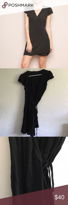 """Brandy Melville Robbie black dress Short sleeve wrap dress in black with a self-tie waist, v-neck front and a flowy fit. Brand new, never worn or washed! This dress is semi-sheer. Fabrics: 58% cotton, 42% viscose Measurements: 34"""" full length, 15"""" bust Made in: Italy Brandy Melville Dresses Midi"""