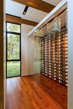 "Altus designs Minnesota home and ""shiny shed"" to blend with .- Altus designs Minnesota home and ""shiny shed"" to blend with the forest Altus designs Minnesota home and ""shiny shed"" to blend with the forest - Modern Glass House, Glass House Design, Cedar Walls, Home Wine Cellars, Minnesota Home, Minneapolis Minnesota, Woodland House, Wine Cellar Design, Wine House"