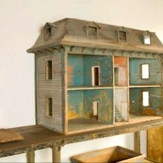 Doll House  I absolutely love this.  it reminds me of homes we grew up in