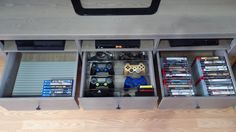 "Video game console storage! IKEA HEMNES TV stand. IKEA INREDA DVD rack in both right and left drawers. Middle drawer: InterDesign Linus Twin Drawer Organizer, 8""Dx16""Wx3""H for 4 controllers and 2 InterDesign Linus Drawer Organizers, 4""Dx8""Wx3""H, for micro & mini USB charging cables. PS4 items on the left, and PS3 items on the right. Excluding the front 'extra' area in the middle front drawer. #playstation #controller #storage"