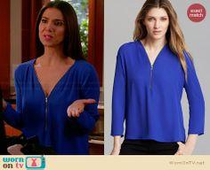 Carmen's blue zip front blouse on Devious Maids.  Outfit Details: http://wornontv.net/33570/ #DeviousMaids