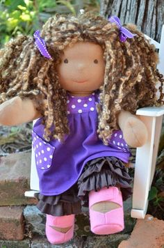 This is Sula, a Bamboletta Sitting Friend from the July 15, 2014 random upload. She has dark tan skin, mid-length hair made with mohair boucle in a multi-tonal brown color and brown eyes. She is wearing the pictured outfit, underpants and wool felt shoes.