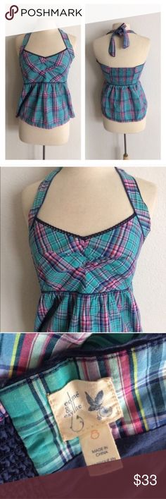 """Edme & Esyllte """"Thrown A Curve"""" halter top Edme & Esyllte """"Thrown A Curve"""" blue plaid halter top. Size 8. 100% cotton. Hidden zipper on the side. Measures approx 25"""" long with a 32"""" bust. The backside has some elastic/ stretch. Very good used condition!  🚫NO TRADES🚫 💲Reasonable offers accepted💲 💰Great bundle discounts💰 Anthropologie Tops"""