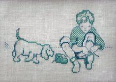 Il ricamo misura 18x13 cm e rappresenta una ironica scenetta tra un bambino che si sta allacciando una scarpa ed il suo cagnolino. Da realizzare a
