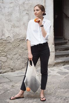 White shirt, black washed crop jeans, black casual flip flops and a beige net tote bag. #fashion2018 #fashiontrends2018 #summerfashion #summerstyle #summervibes #netbag #nettote #blackandwhite #minimalstyle Spring outfit, summer outfit, simple outfit, casual outfit, comfy outfit, black and white outfit, minimal outfit, minimalist, minimal style.
