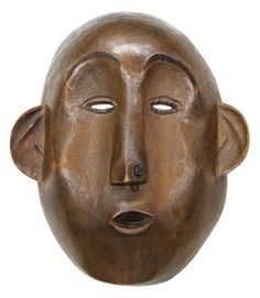"""Makonde, Tanzania, carved wood mask, early 20th century, having stylized facial features and prominent ears, museum accession number 1978.864, 9""""h  Provenance:  Property deaccessioned from The Art Institute of Chicago. Estimate: $4,000 - $6,000. #ethnographic #ethno #tanzania #mask"""