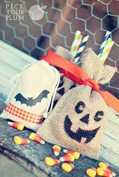 bat heat transfers and stenciled pumpkins make cute Halloween favor bags!