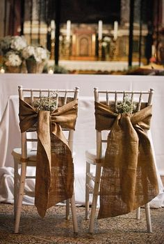 Burlap tied to backs of chairs if you do not like the upholstered chair idea. #wedding #chairs