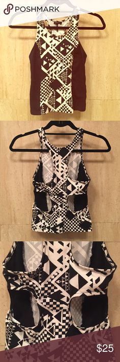NOLLIE Cropped Racerback Tank Trendy black and white Nollie cropped Racerback Tank with cutouts in the back. Fitted. 95% cotton. 5% spandex. Nollie Tops Crop Tops