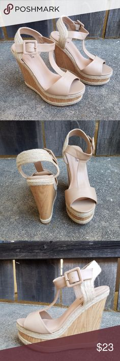 """Shoedazzle Hanni Nude Chunky Wedges Versatile nude open toe wedge heels. Features braided jute trim, faux wood heel, and large buckle detail. Strap material is soft and flexible. Heel part is hollow so they're not super heavy.   Heel measures approx 6.25"""" tall with a 2"""" platform.   Small imperfection on right heel on edge that can be seen in last photo.  New in box, labeled size 10. ShoeDazzle Shoes Wedges"""