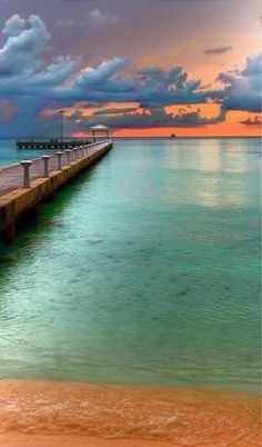 Aqua/Turquoise & Orange pier at the beach sunset