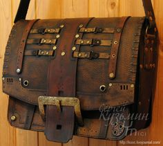 This bag kinda reminds me if my leather bag from Italy! I really like the added belts and details!