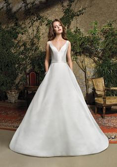 3f18ff2e3f The luxurious A-line skirt features pockets and flows into a Chapel train.  Also Available in Satin |royal wedding dresses ...