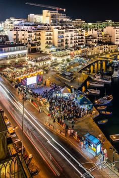 Image ID# 120609-3380   Hotel Juliani At Night One A night view of Spinola Bay in the St Julian's district of Valletta, Malta where a crowd has gathered to watch the Euro 2012 soccer tournament.