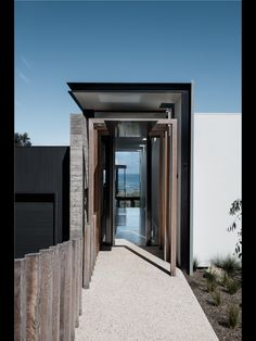Love the different colours and textures of wood, rammed earth, concrete, metal, glass etc to make this costal yet elegant
