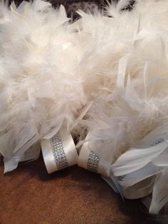 Feather pomander bouquets instead of flowers. Black white and rhinestone wedding Adam & Tina 10.4.2013