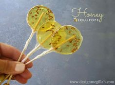 Honey Lollipops -  Makes 1 doz  1 cup sugar  1 cup honey  2/3 cup light corn syrup  Flax seeds optional  1. Prepare an ice water bath & set aside.  2. Combine sugar, corn syrup and 1/4 cup of water, boil in saucepan, stir until sugar dissolves.   3. After about 5 minutes or so (candy thermometer 300 - 310 deg).  4. Quickly set pan in the ice-bath water to stop the cooking & sit about 20 sec.   5. Pour syrup into candy molds, press in sticks.   6. Let harden and cool.