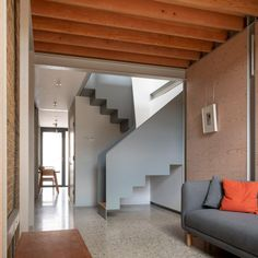 Throughout the house the architects combined the steel structure with exposed Douglas fir joists, spruce plywood walls and cork and terrazzo floors. Stair Railing, Stairs, Railings, Plywood Walls, Riverside House, Two Storey House, Narrow House, Terrazzo Flooring, Planning Permission