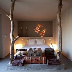 I love the exposed tree trunks at the foot of the bed. I seem to have a correlation in my head with bedrooms and trees. Probably from growing up in a forest and hearing the trees whip against the house in a winter storm and snuggling under the blankets. Yum!