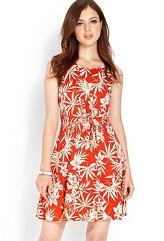 Love 21 - A sleeveless woven dress featuring an island print with cutout front detail. Finished w...