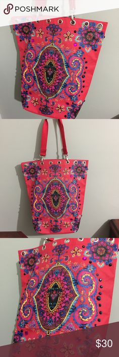 """Oilily beach bag/tote Beautiful embellished tote bag/beach bag. Measures 17"""" long 16"""" across the top. And the hard bottom measures 9"""" x 7"""". 11"""" drop on the handle so you can throw it over your shoulder. Some small spots inside and small wear on side down the seam (not really noticeable) Shown in photos. Still in great shape with lots of years left in it. Oilily Bags Totes"""