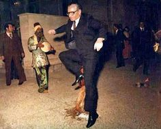 Aww! Mohammad Reza Shah jumping over fire on Charshanbe Soori.