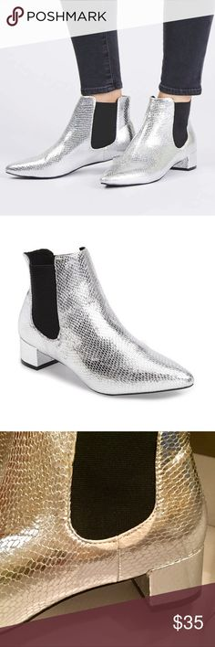 Topshop Metallice Silver Chelsea Booties Worn inside the house which created slight creases. Otherwise, bottom of the shoes are perfect. Has a slight printing imperfection - see photo. Don't have box but will put it in a different shoe box. Size 36 - 5.5 Topshop Shoes
