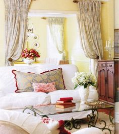 Love the sunny yellow walls, white sofa, and red accents.....