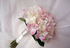 rhinestone buckle accent, made with white roses, white cymbidium orchids, light pink dendrobium orchids wedding flower bouquet, bridal bouquet, wedding flowers, add pic source on comment and we will update it. www.myfloweraffair.com can create this beautiful wedding flower look.