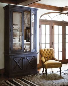 Simple Details- change an old entertainment cabinet  add glass to doors and x moldings