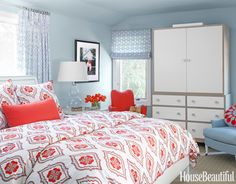 This bedroom was designed around the duvet cover which I think looks amazing.   I love how designer Matthew Leverone was able to use the bright orange in playful pops around the room, but make it restful by adding a silvery blue color (which is also from the duvet if you look close!)